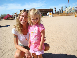 Woman and young girl at pumpkin patch