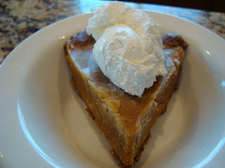 Vegan No Bake Pumpkin Pie on white dish topped with vegan whipped cream