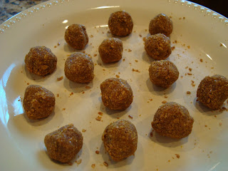 Raw Vegan Pumpkin Spice Donut Holes formed on white plate
