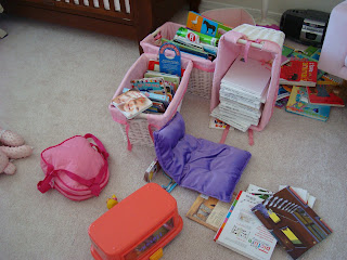 Childs room showing a mess of items on floor