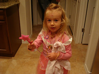 Young girl in fairy princess costume holding wand