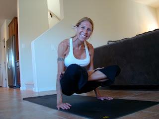 Woman doing Lolasana yoga pose