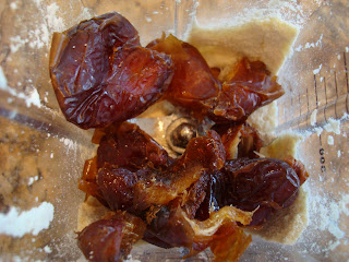 Ground cashews and whole dates in blender