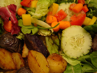 Overhead of mixed salad and potatoes on plate