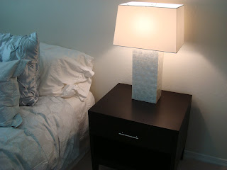 Black side table with lit up lamp