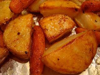 Close up of cooked red and yukon gold potatoes and baby carrots