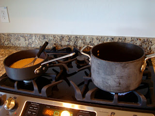 Gravy being made on stove in pan with whisk