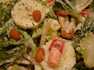 Homemade Cesar Salad up close topped with almonds