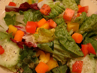 Simple green salad with diced vegetables white shallow dish