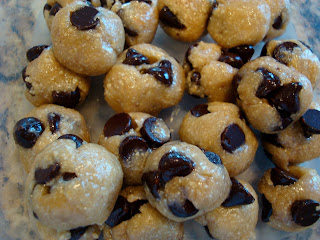 Overhead of Raw Vegan Chocolate Chip Cookie Dough Balls in clear container