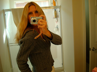 Woman showing off new hair in mirror