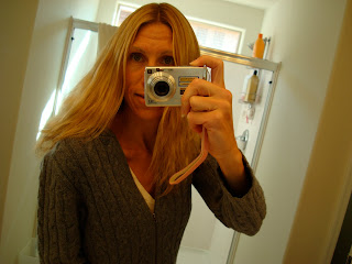 Woman facing mirror showing off new hair