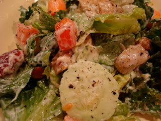 Close up of Green salad with turnkey and vegetables with ranch dressing