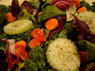 Mixed green salad with sliced vegetables