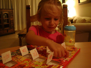 Young girl opening advent calendar