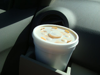 To-Go Cup of coffee in cup holder in car