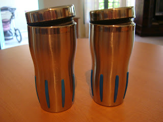 Two silver reusable mugs on tabletop
