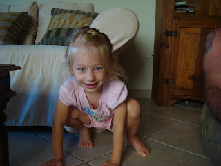 Young girl squatting on floor after playing yoga