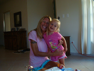 Woman and young girl hugging and smiling
