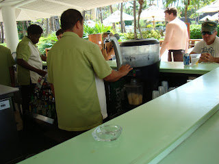 Sitting at bar looking at bartenders