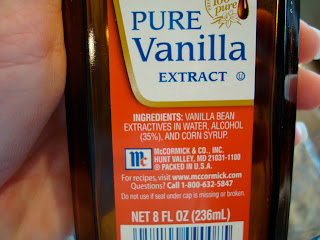Hand holding bottle of Pure Vanilla Extract
