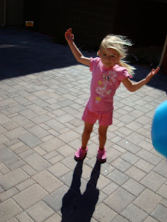Young girl with arms up in wind