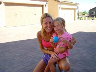 Woman and child embracing while child holds blue ball