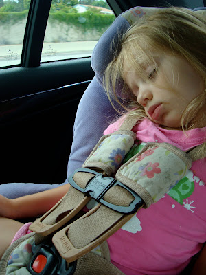 Young girl in car seat sleeping