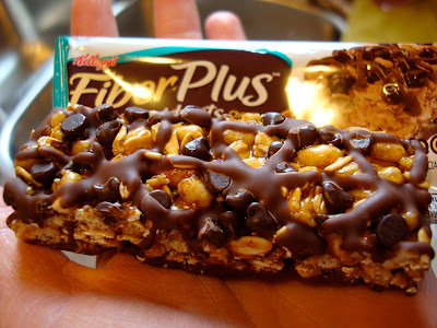 Fiber Plus Bar out of packaging showing chocolate chips and drizzle