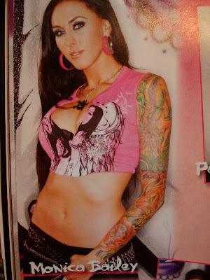 Photo of woman in magazine with a full sleeve tattoo