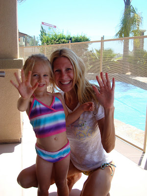 Woman and child in bathing suit waving