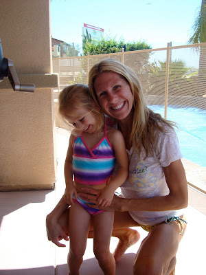Woman and child in front of pool smiling