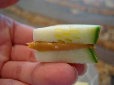 Hand holding a cut Peanut Butter Sandwich