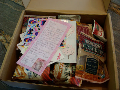 Box full of Mary's Gone Crackers with note on top