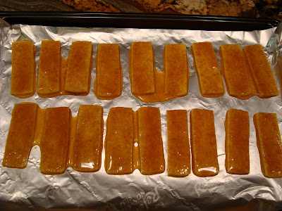 Marinated tofu in single layer on foil lined baking sheet
