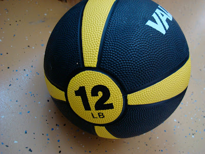 Side view showing 12 LB on Medicine Ball