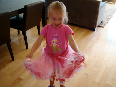 Young girl wearing pink and white tutu