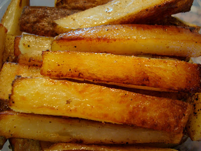 Close up of stacked Coconut and Olive Oil Roasted Potato Sticks