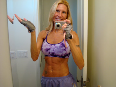 Woman showing off toned abs