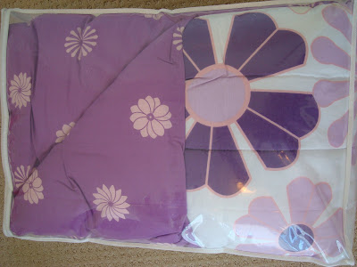 Purple and white bedding with flowers