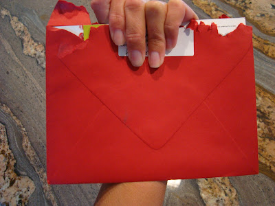 Hand holding opened Red Envelope