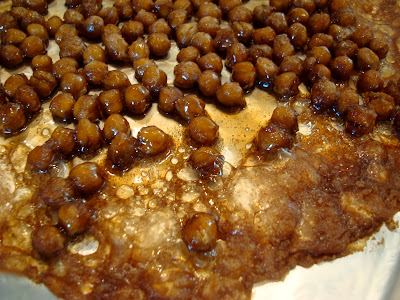 Close up of Carmelized Cinnamon Sugar Roasted Chickpea Peanuts after 20 minutes of baking