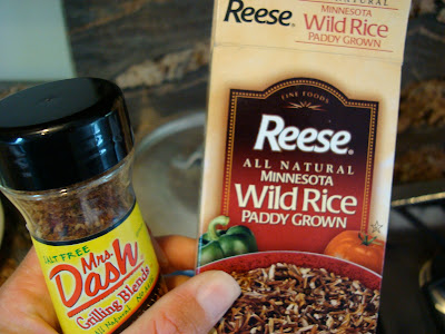 Hand holding package of Wild Rice and Mrs. Dash