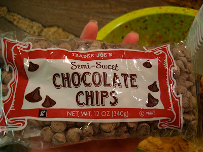 Hand holding bag of semi-sweet chocolate chips