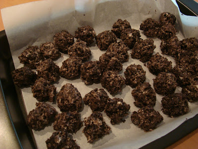 Formed Chocolate Covered Oreo Balls on parchment lined baking sheet