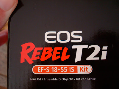 Close up of box that includes an EF-S 18-55 IS lens