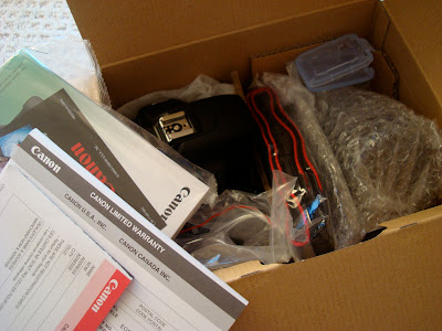 Inside box of camera with supplies