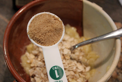 Brown sugar being added to banana oat mixture