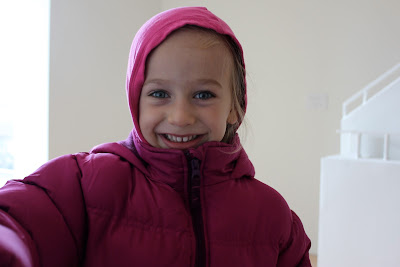 Close up of girl in jacket with a hood pulled up