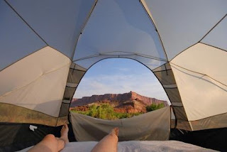 view of sunrise from inside of a tent